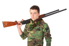 Man in camouflage with gun on shoulder Royalty Free Stock Photography