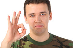 Man in camouflage shows gesture ok Royalty Free Stock Images