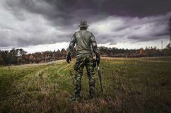 Man in Camouflage Suit Holding Shotgun Royalty Free Stock Photos
