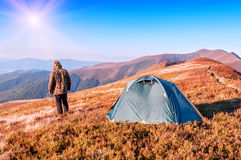 Man in camouflage and tent Stock Photo