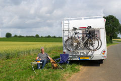 Man with camper in landscape. Man with camper in agriculture landscape Stock Photo