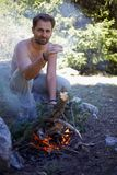 Man and campfire Stock Photo