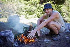 Man and campfire Royalty Free Stock Image