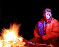 Man by campfire Royalty Free Stock Photo