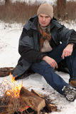 Man at campfire in winter Royalty Free Stock Photo