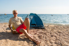 Man camping at the beach Royalty Free Stock Images
