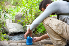 Man with camping gas in nature Stock Image
