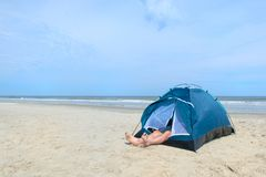 Free Man Camping In Shelter At The Beach Royalty Free Stock Photo - 166126335