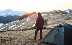 Man camping in the mountains Stock Image
