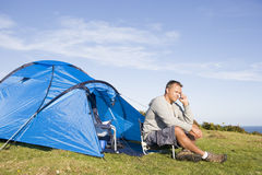 Man camping outdoors. On a sunny day stock photography