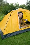 Man camping in tent. Young man camping in tent royalty free stock image