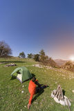 Man camping with a tent in the mountains . Royalty Free Stock Photos