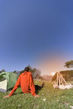 Man camping with a tent in the mountains . Royalty Free Stock Photography