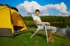 Man at the campsite Stock Images
