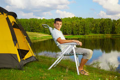 Man at the campsite Stock Image
