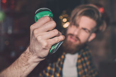 Man with can in messy room after party Royalty Free Stock Images