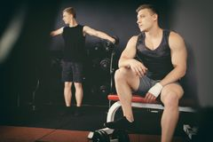 Man can not do exercises with dumbbells stock photos