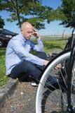 Man can not fix bike problem. Man can not fix a bike problem Stock Photos
