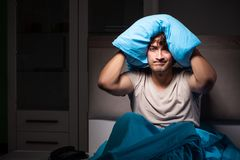 The man can not sleep due to noise neighbor. Man can not sleep due to noise neighbor stock photography