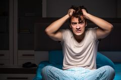 The man can not sleep due to noise neighbor. Man can not sleep due to noise neighbor royalty free stock images