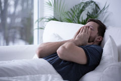 Man can't fall asleep. Person suffering from insomnia trying to get some sleep stock photography