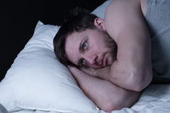 Man cannot get any sleep. Young man having sleepless nights because of insomnia royalty free stock photography