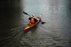 Man in canoe. A man canoing on the lake Royalty Free Stock Photo