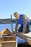 Man with canoe. Man holding canoe at dock on Lake of Two Rivers, Ontario, Canada Royalty Free Stock Photos