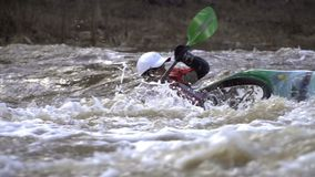 A man in a canoe against the strong current of the river. stock video