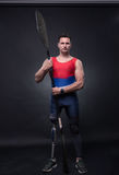 Man canoe kayak paddle, athlete sportsman, prosthetic leg, disab. One young adult man only, canoe kayak paddle, athlete sportsman, prosthetic leg, disabled Royalty Free Stock Photos