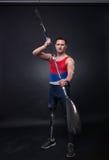 Man canoe kayak paddle, athlete sportsman, prosthetic leg, disab Stock Photography