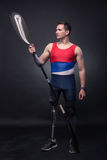 Man canoe kayak paddle, athlete sportsman, prosthetic leg, disab Stock Image