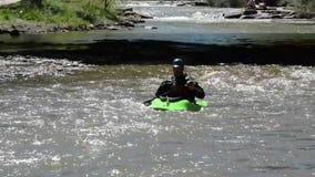 Man in canoe stock video footage
