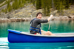 Man Canoe Portrait. A portrait of a smiling man in a canoe on a glacial lake royalty free stock images