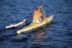 A man canoeing Royalty Free Stock Images