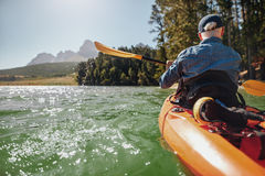 Man canoeing in a lake Royalty Free Stock Images