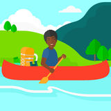 Man canoeing on the river. Stock Photo