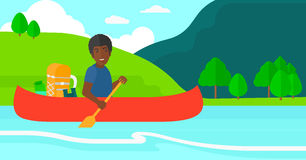 Man canoeing on the river. Stock Images