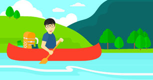 Man canoeing on the river. Stock Photography