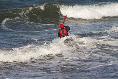 Man canoeing into waves. Man canoeing into surf and waves in sea Stock Image