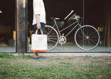 Man with canvas bag and vintage bicycle on background Royalty Free Stock Images