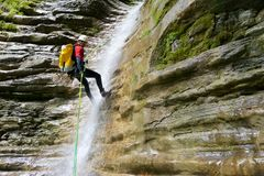 Man canyoning in Pyrenees, Spain. Canyoning in Furco Canyon, Broto, Pyrenees, Huesca Province, Aragon in Spain stock photos