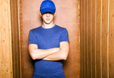 Man in cap. Young man in dark blue clothes Stock Image