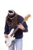Man with cap and bass guitar Stock Photo
