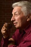 Man with cap of coffee Stock Photos