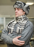 Man in a cap with earflaps Stock Photography
