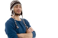 Man with cap and folded hands Stock Photos