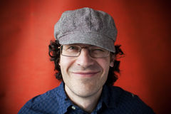 Man in a cap and glasses. Winking eye Stock Photo