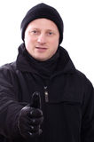 Man with cap and gloves hold his thumb up Stock Photos