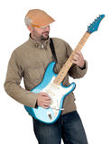 Man with cap playing electric guitar Royalty Free Stock Photos